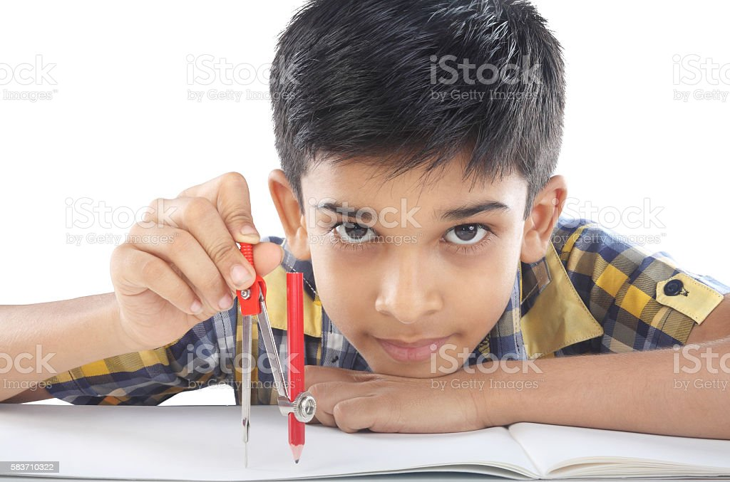 Indian boy with drawing compass stock photo