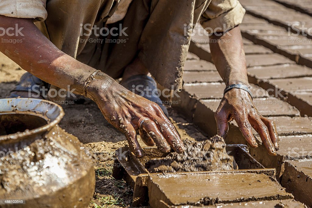 Indian Brick Worker stock photo
