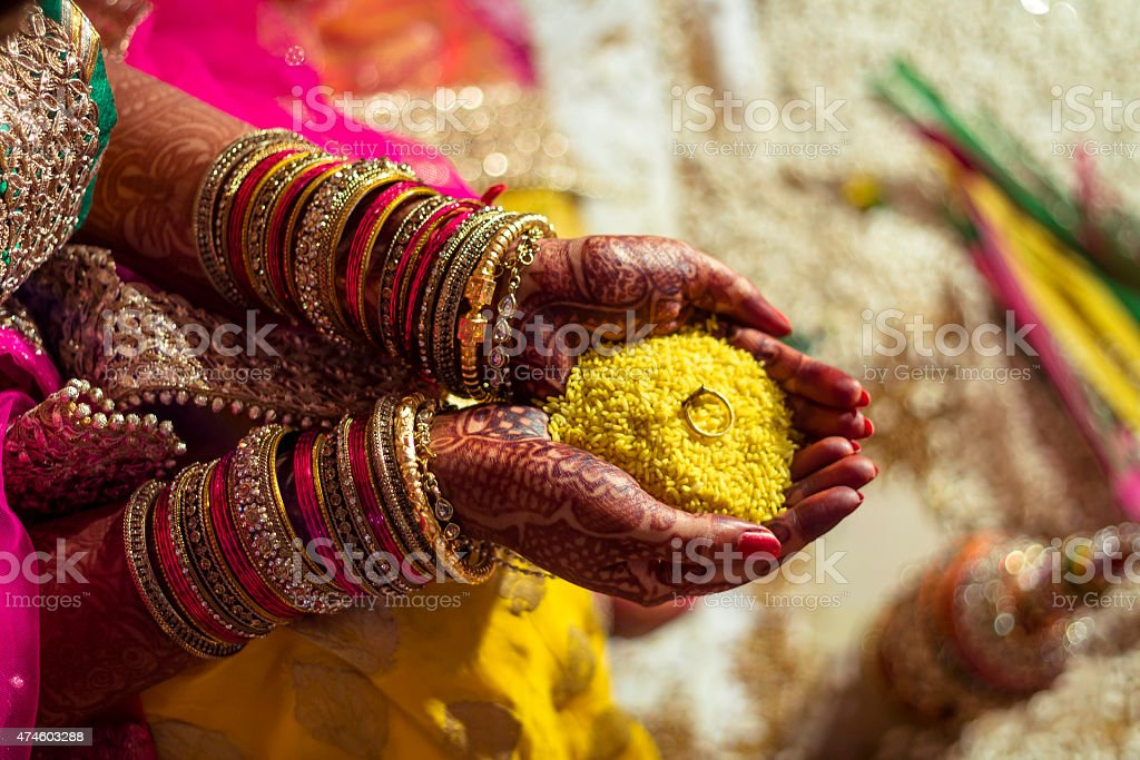 Indian bride performing rituals stock photo
