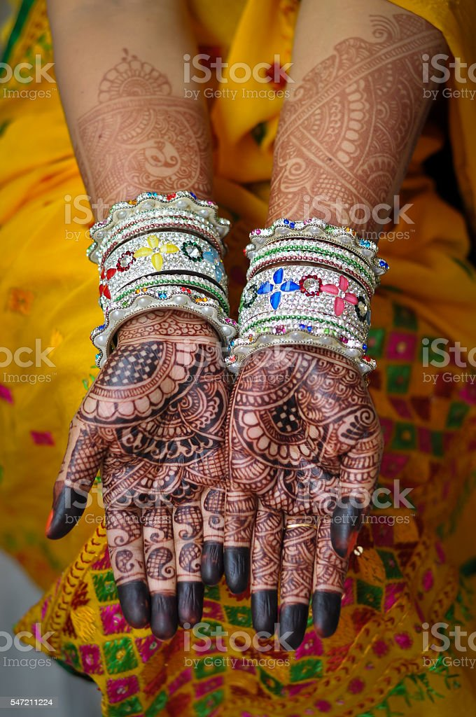 Indian bride showing henna and bangles stock photo