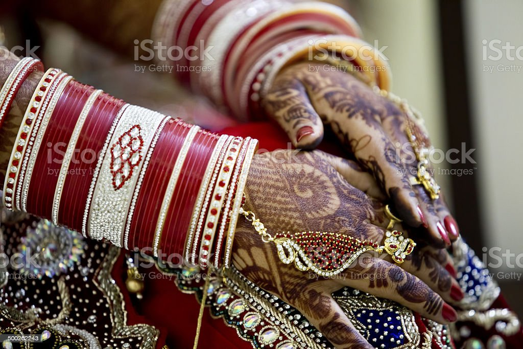 Indian bride with heena tattoos stock photo