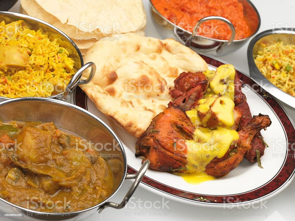 Indian Buffet Assorted Curries with Tandoori Chicken Naan Bread stock photo