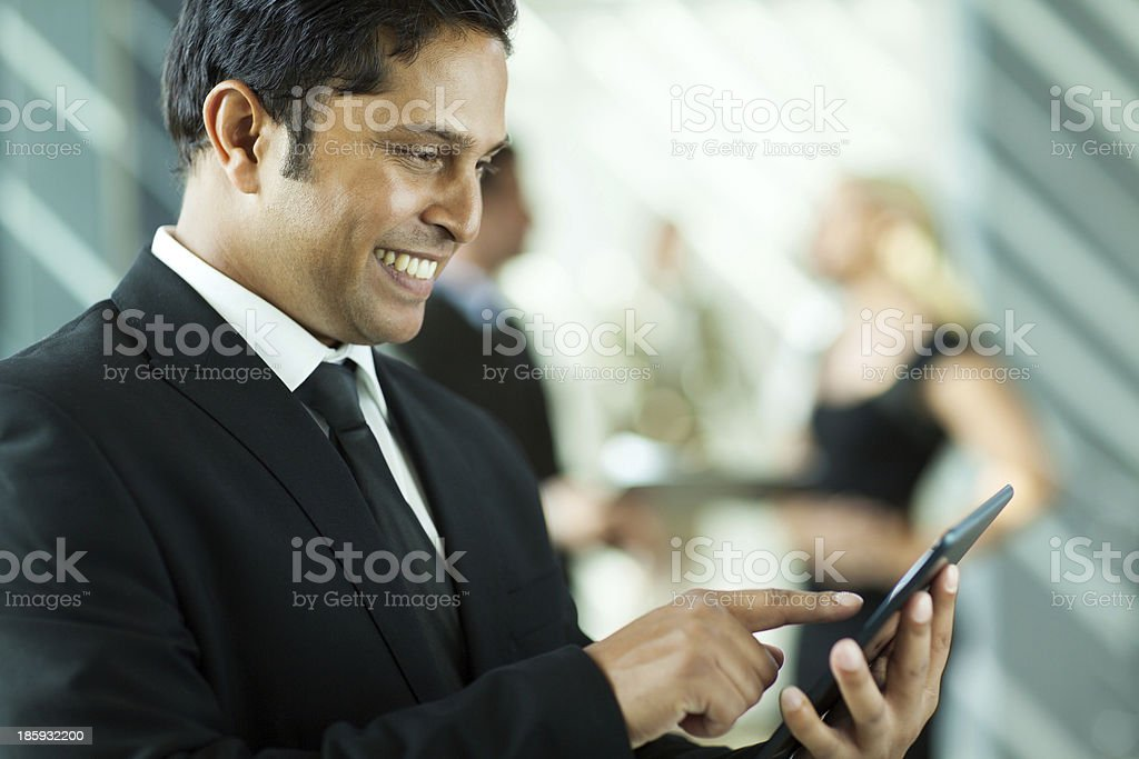 indian business executive working on tablet computer royalty-free stock photo