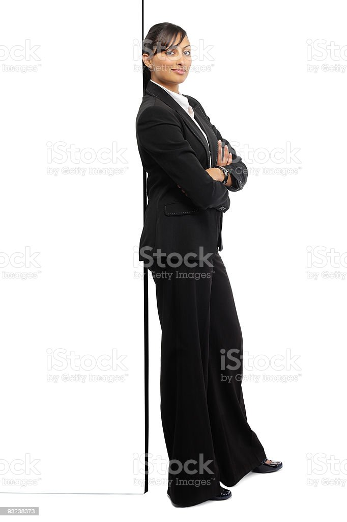 Indian Business woman leaning on a wall over white background royalty-free stock photo