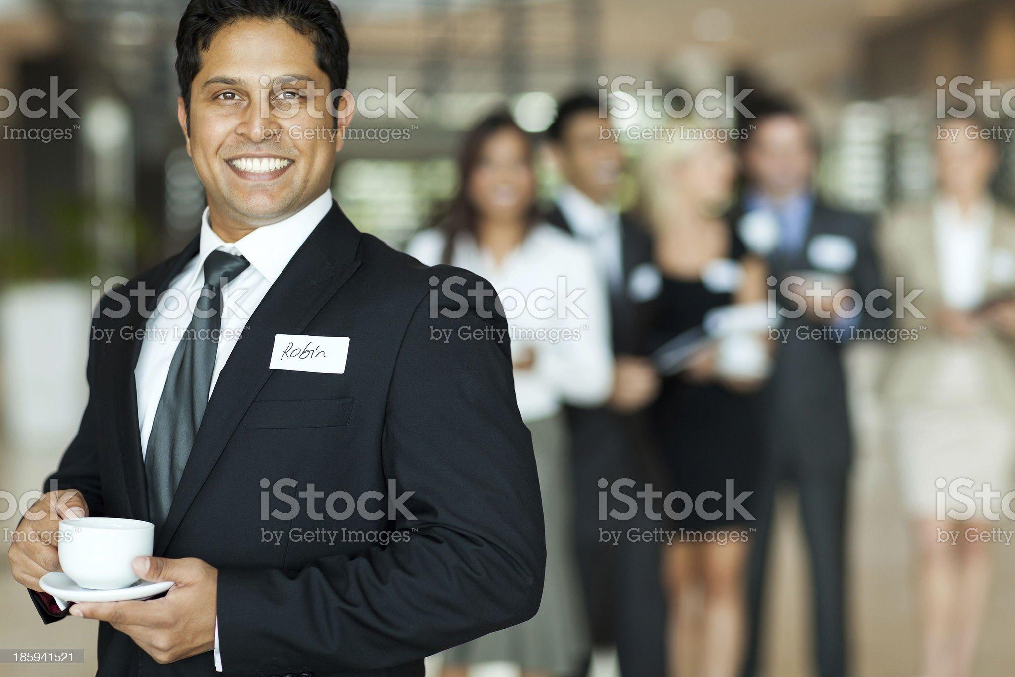 indian businessman having coffee break during seminar royalty-free stock photo