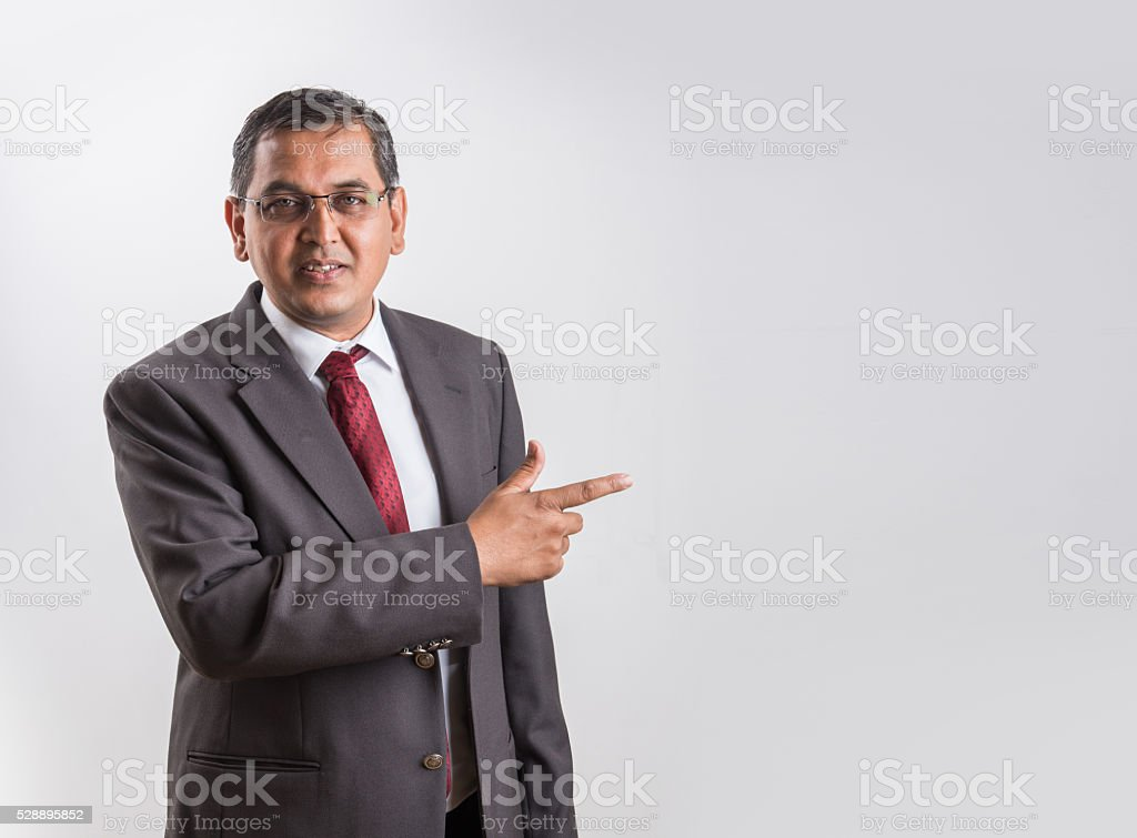 indian businessman presenting or giving presentation over white background stock photo