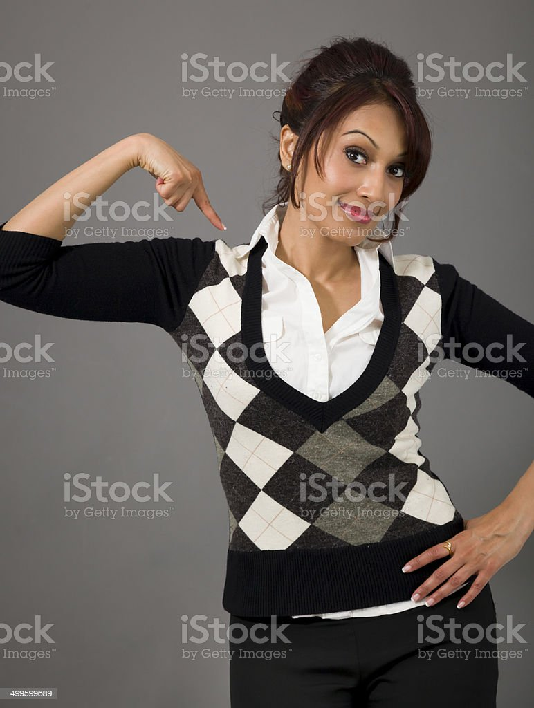 Indian businesswoman pointing at herself isolated over colored background royalty-free stock photo