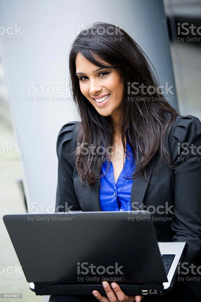 Indian businesswoman with laptop royalty-free stock photo
