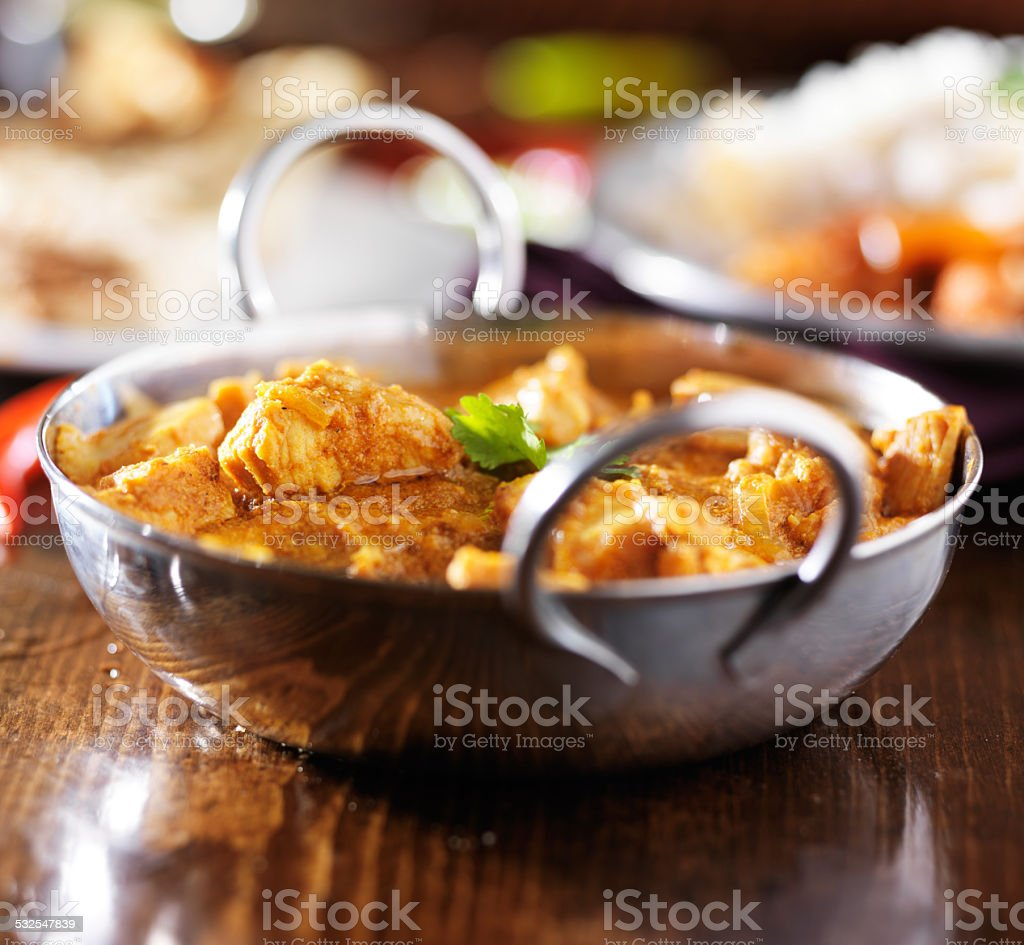 indian butter chicken curry in balti dish with basmati rice stock photo