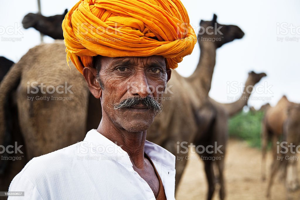 indian camel herder Pushkar cattle fair royalty-free stock photo