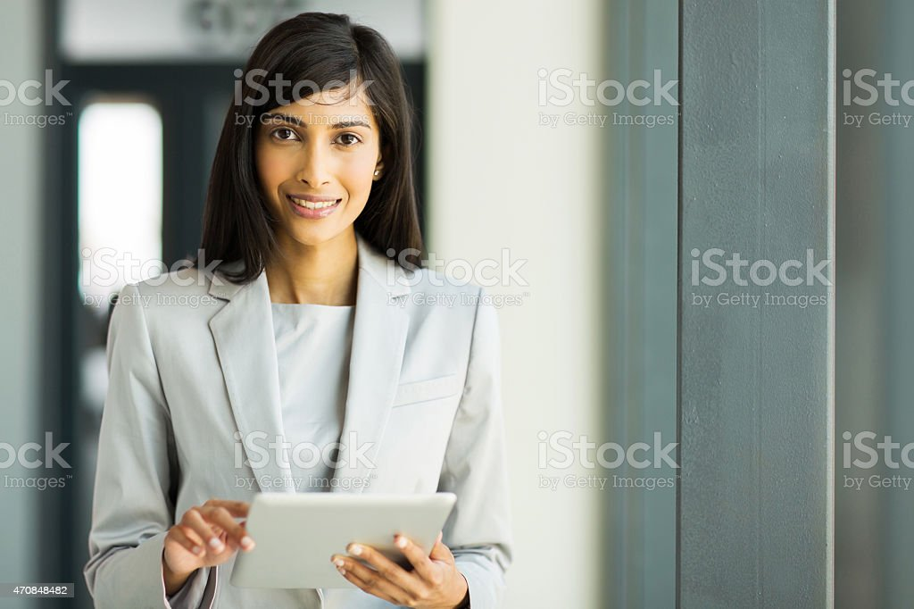 indian career woman using tablet pc stock photo