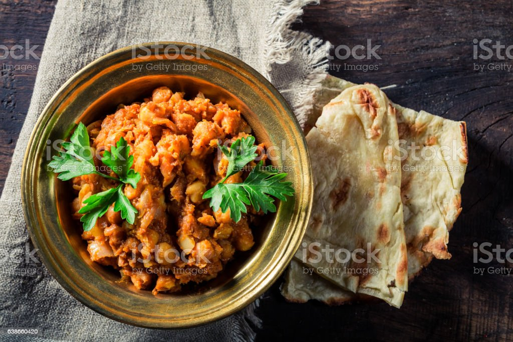 Indian Channa Masala with chickpeas and Naan bread stock photo