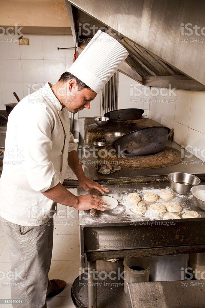 Indian Chef preparing Roomali Roti stock photo