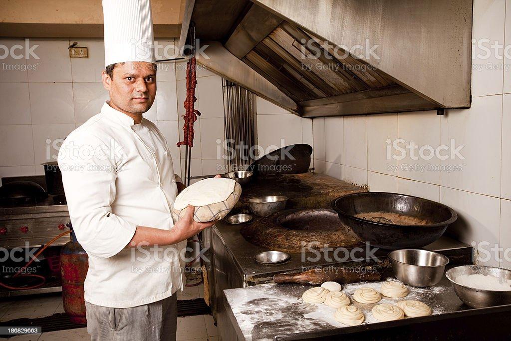 Indian Chef preparing Tandoori Naan/Roti royalty-free stock photo