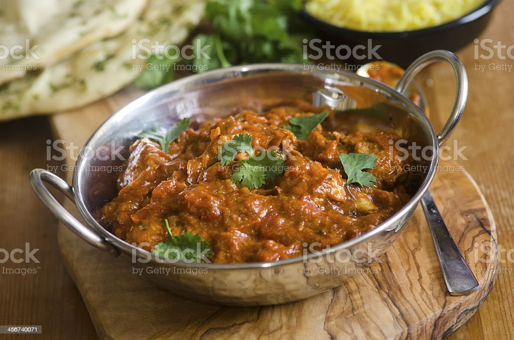 Indian Chicken Balti dish in a silver bowl stock photo