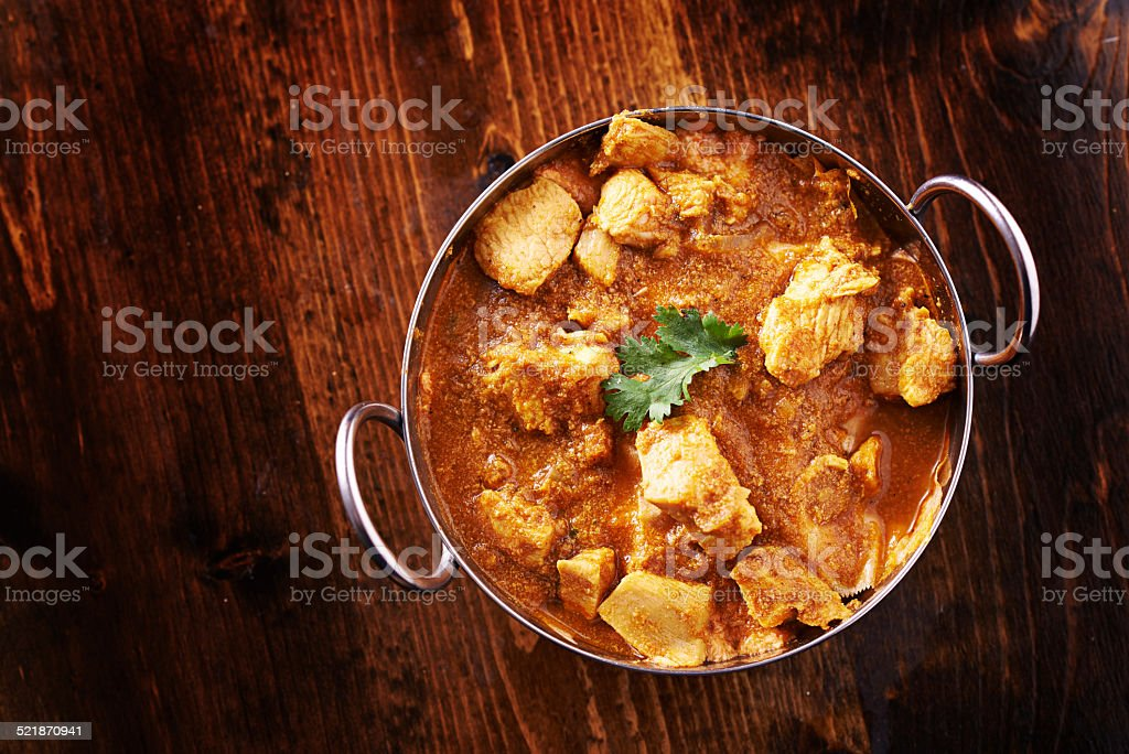 indian chicken curry in balti dish overhead photo stock photo