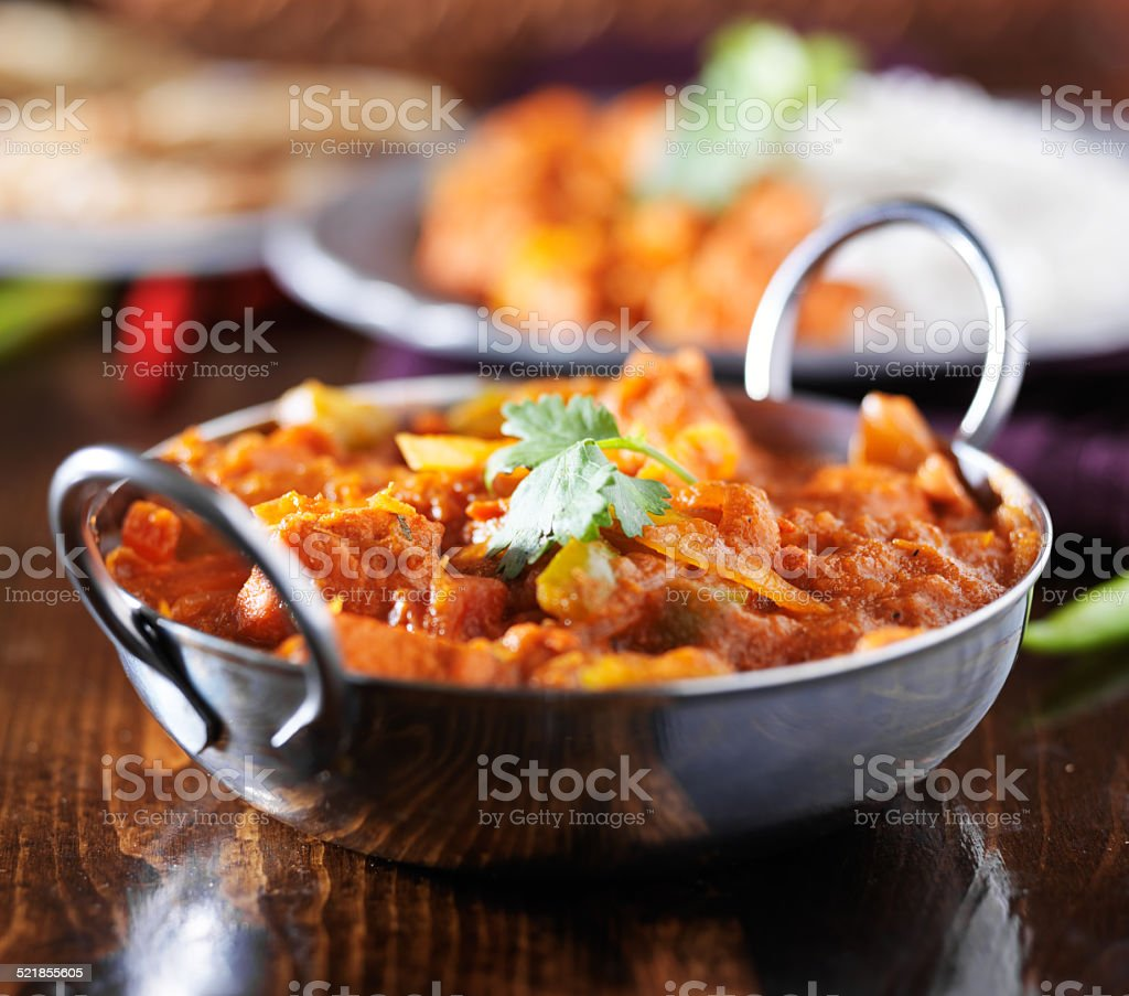 indian chicken vindaloo curry in balti dish stock photo
