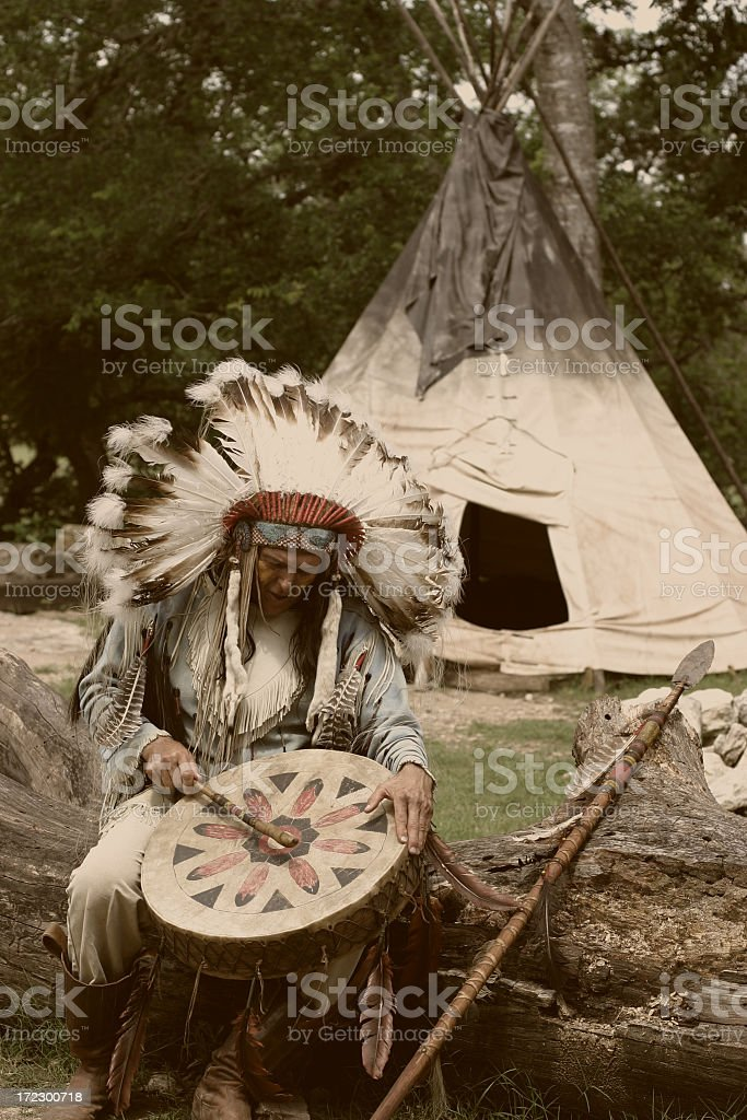 Indian Chief in front of his Tipi stock photo
