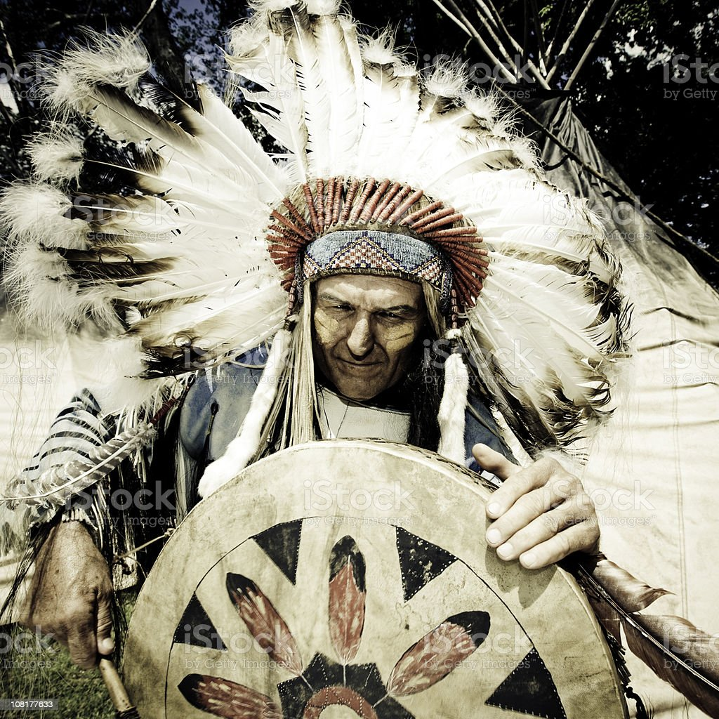 Indian Chief Playing Drum stock photo