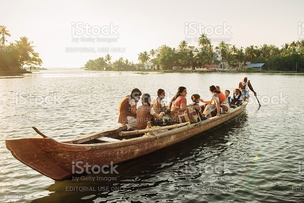 Indian children get to school by boat stock photo