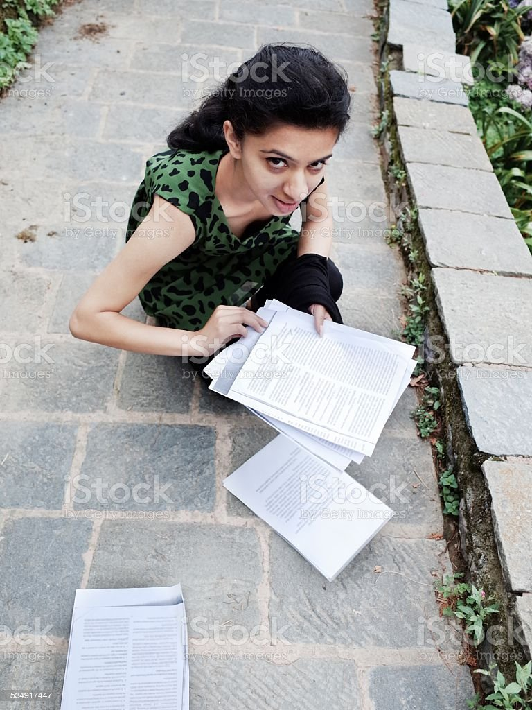 Indian college student arranging her sheets. stock photo