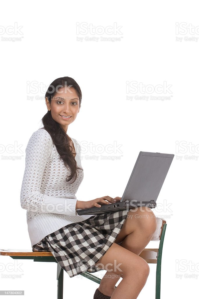 High School Student Sitting At Desk
