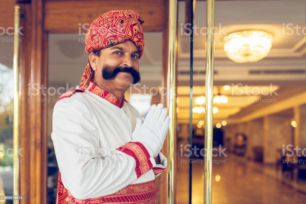 Indian Concierge Welcome Guest at Hotel Entrance Agra India stock photo