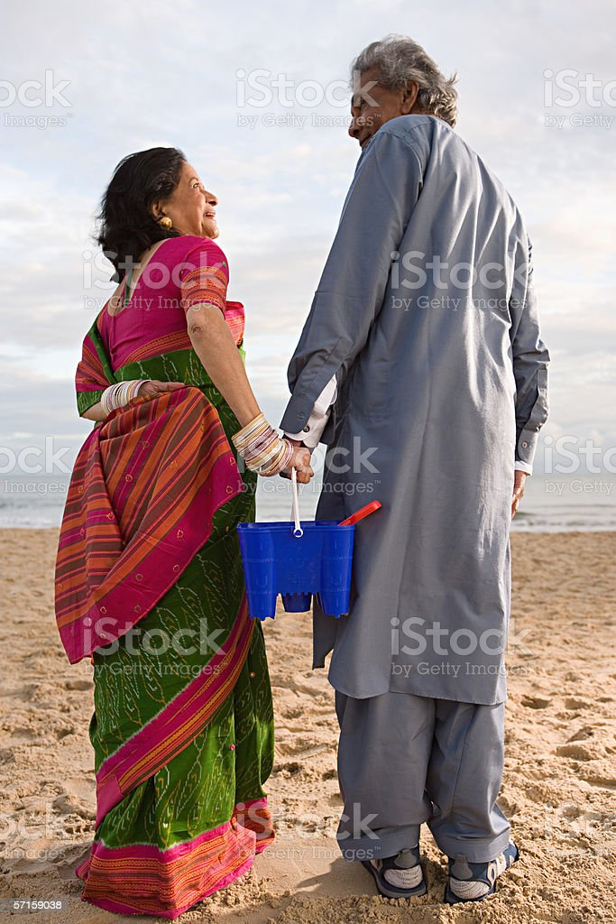 Indian couple at the beach royalty-free stock photo