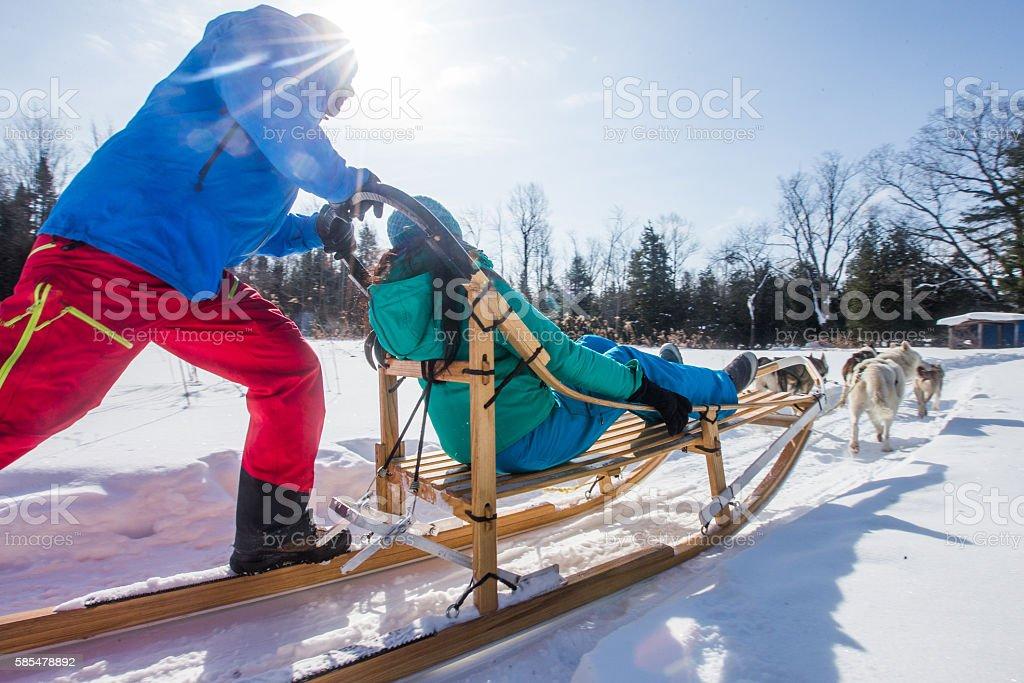Indian couple dogsledding stock photo