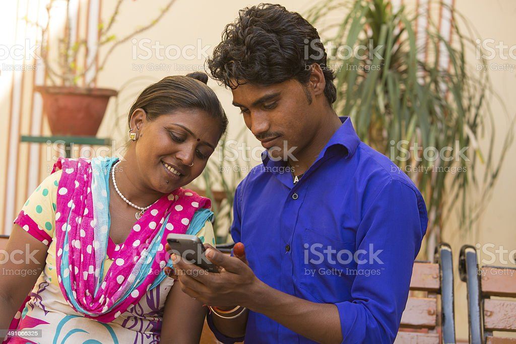 Indian Couple Using a Smart Phone stock photo