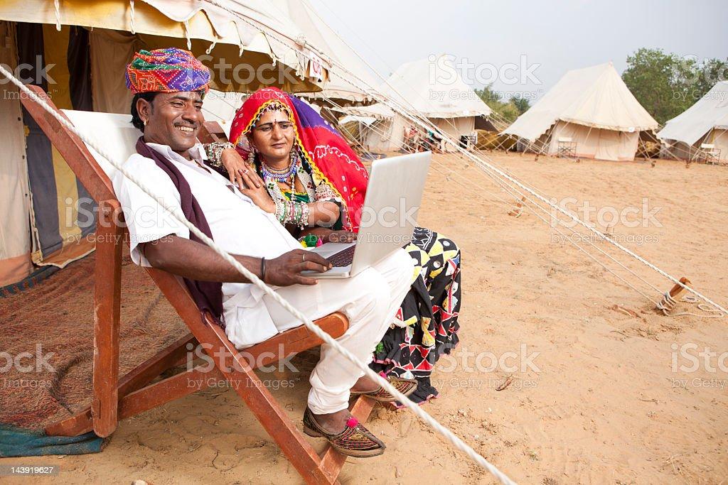 Indian couple vagabonds traveling in desert tents, Pushkar, India royalty-free stock photo