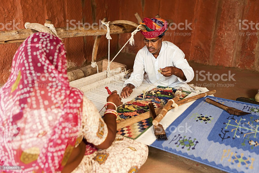 Indian couple weaving textiles (durry). Salawas village. Rajasthan. royalty-free stock photo