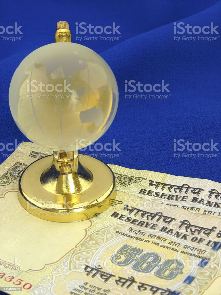 Indian Currency & Globe stock photo