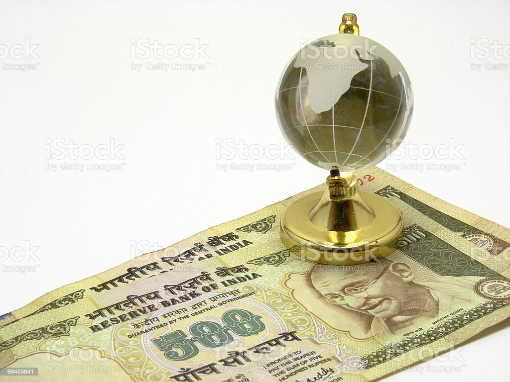 Indian Currency & Globe royalty-free stock photo