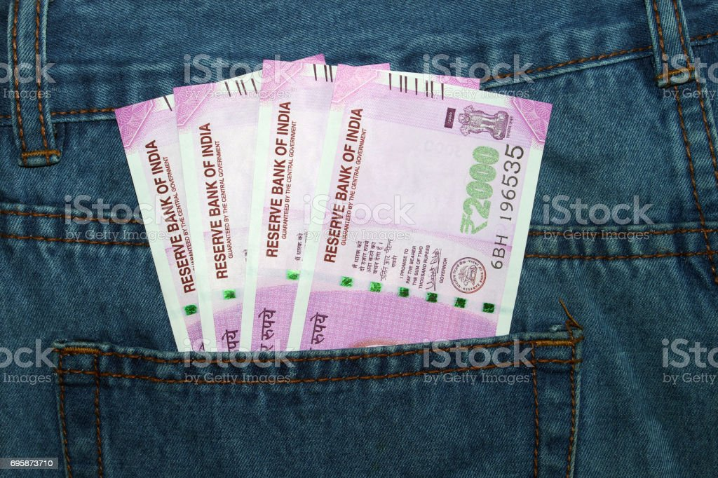 Indian currency in a man's jean back pocket. stock photo