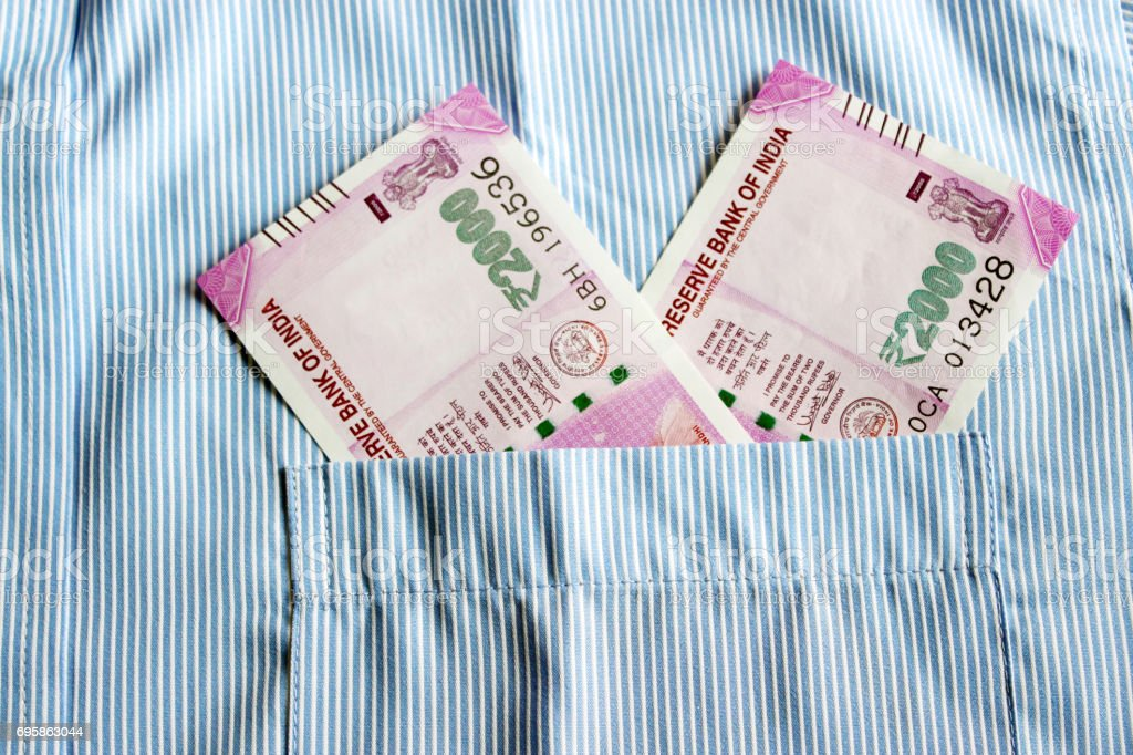 Indian currency in shirt's pocket. stock photo