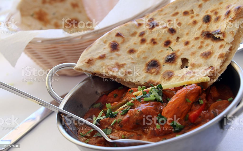 Indian curry with naan bread stock photo