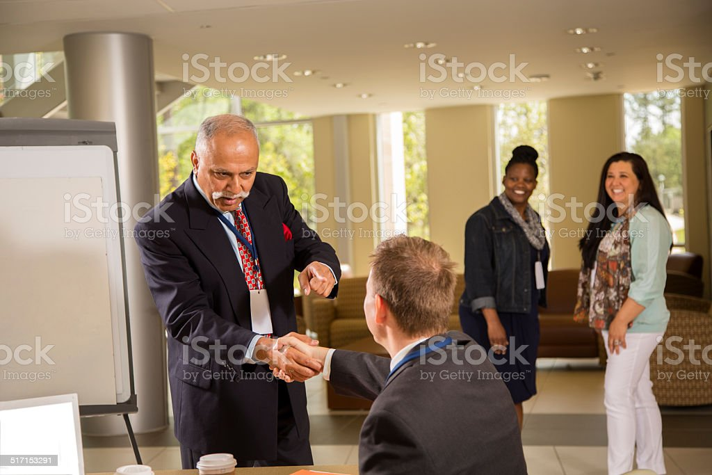 Indian descent, male manager conducts business presentation. stock photo