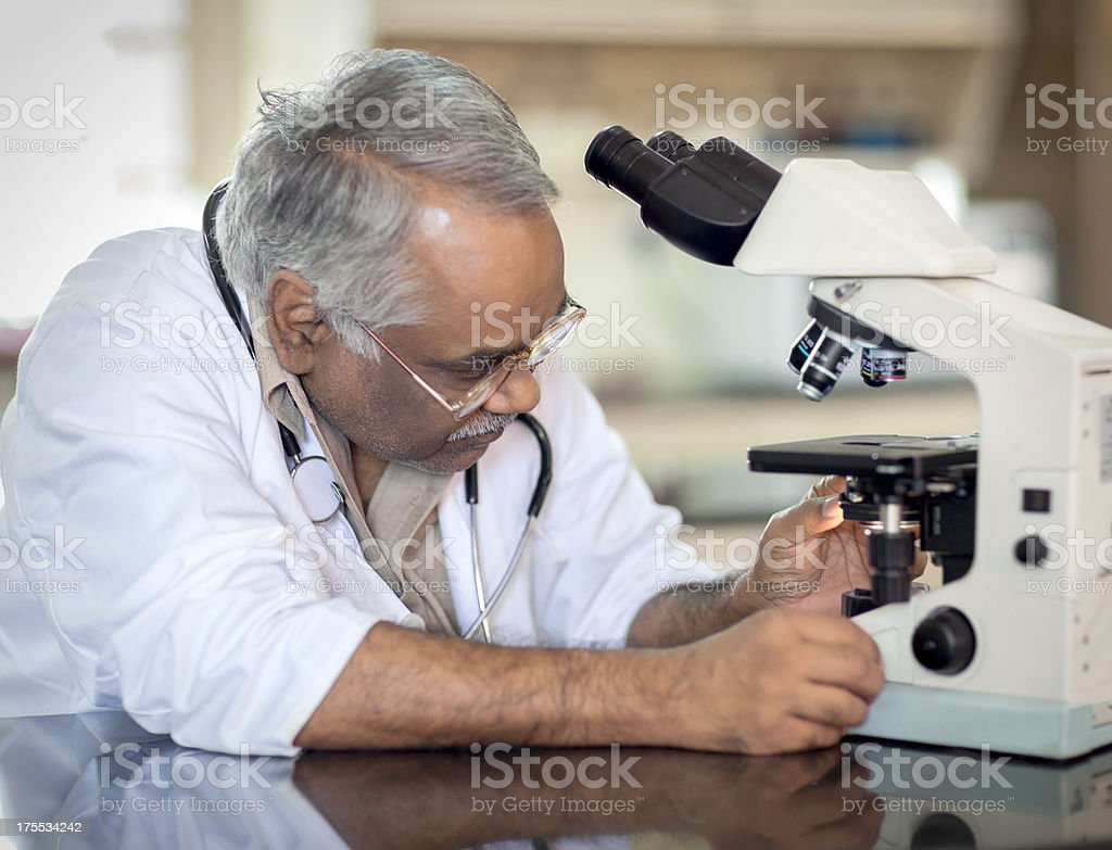 Indian Doctor Using Microscope In Laboratory royalty-free stock photo