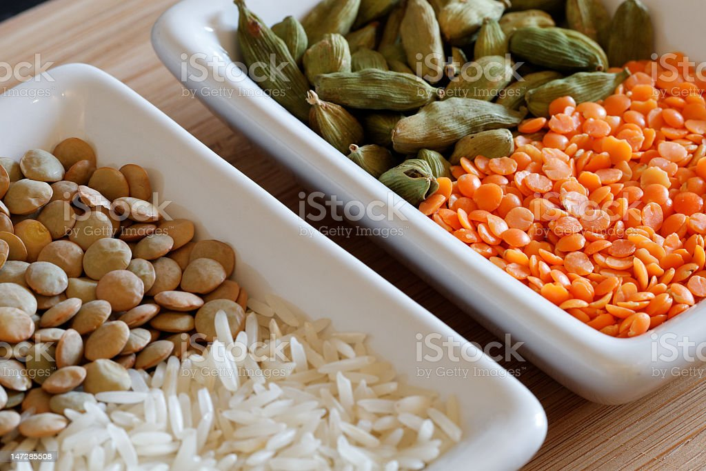 Indian dry ingredients in small bowls royalty-free stock photo