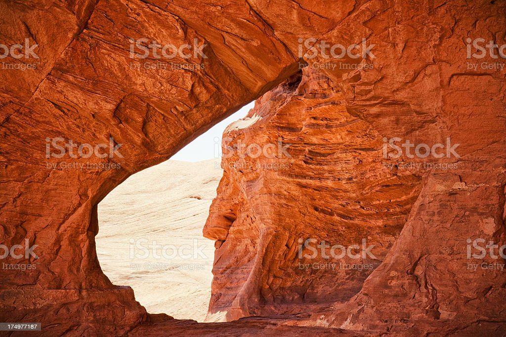 Indian Face Through Double Arch in Mystery Valley - Monument.Valley stock photo