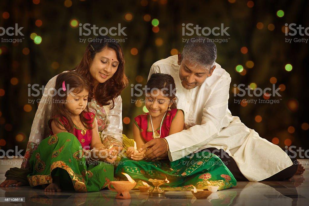 Indian family celebrating Diwali, fesitval of lights stock photo