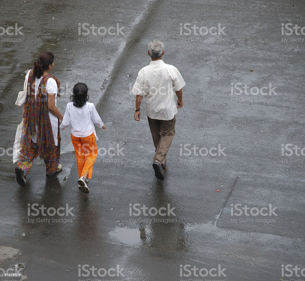 Indian family crossing the road, Mumbai royalty-free stock photo