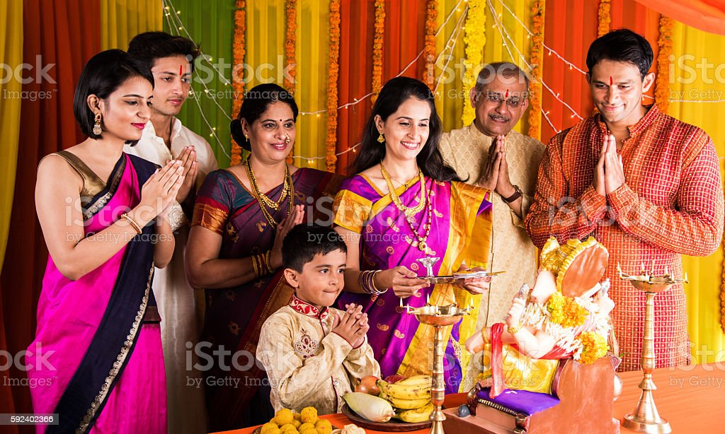 indian family doing ganesh puja or ganesha pujan stock photo