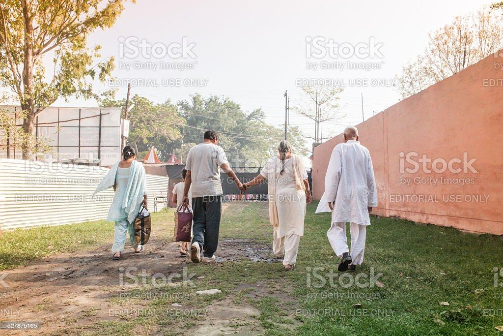 Indian family walking to go praying at kumbh Mela stock photo