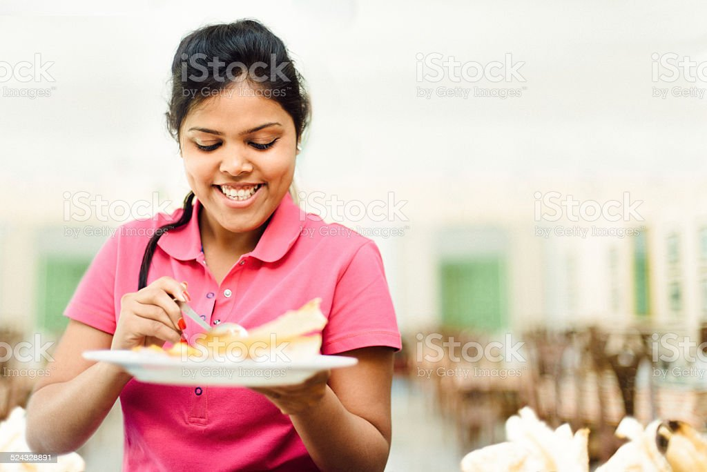 Indian female student in canteen buffet stock photo