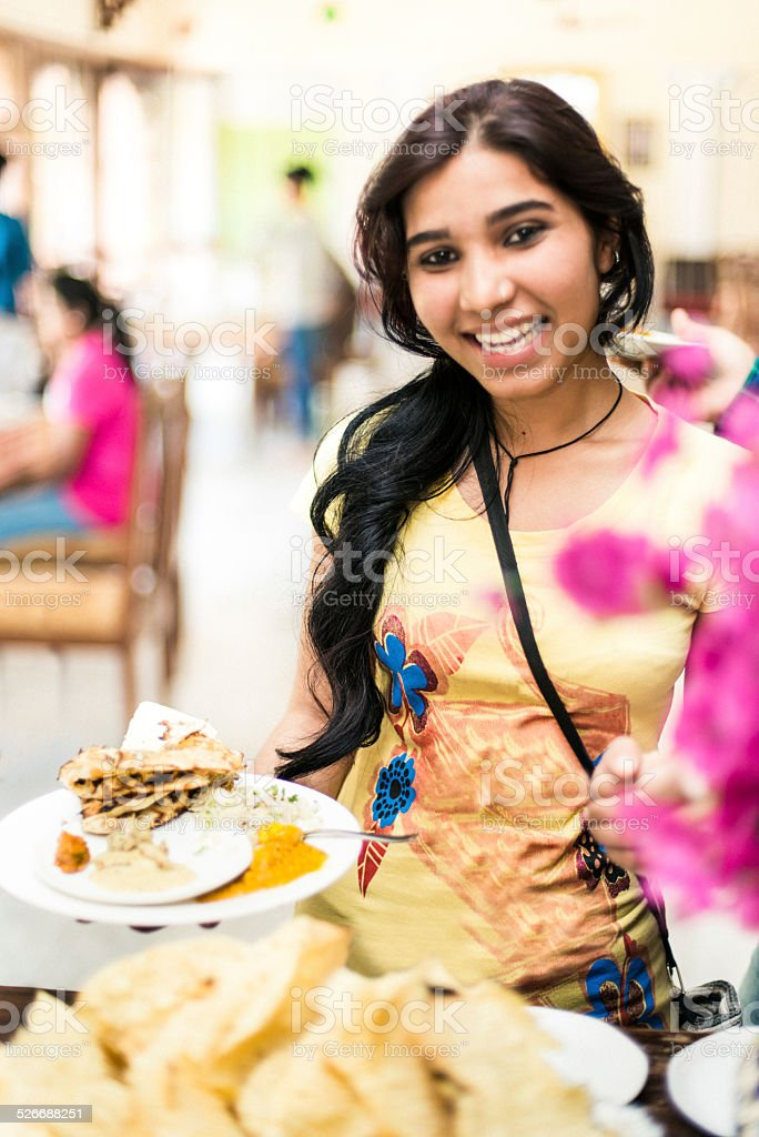 Indian female student in restaurant buffet stock photo