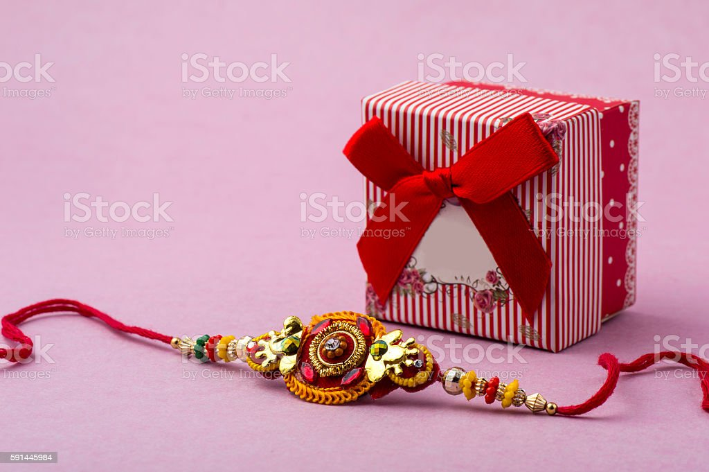 Indian festival Raksha Bandhan background with elegant Rakhi and gift stock photo