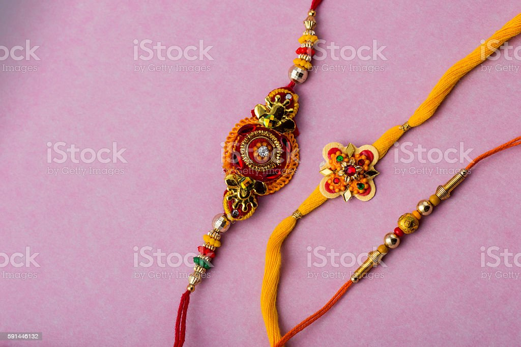 Indian festival: Raksha Bandhan background with Rakhi. stock photo