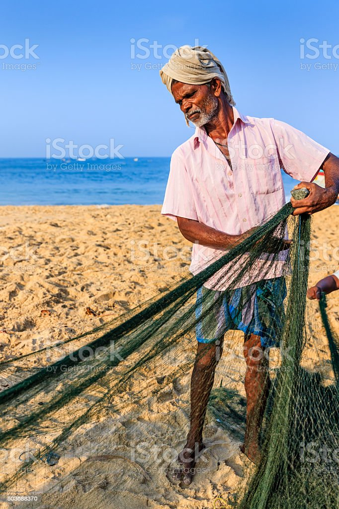 Indian fisherman preparing fishing nets, Kerala, India stock photo